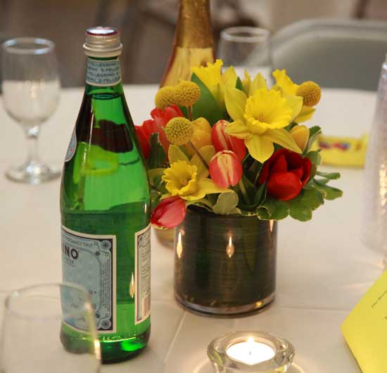 Daffodils, tulips, and craspedia make up the centerpieces provided by Honeyfield Flowers.
